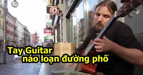 Nghệ sĩ đường phố đanh guitar kinh điển