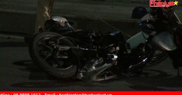 Nhiều xe máy đổ cầu va chạm khiến 2 người nhập viện