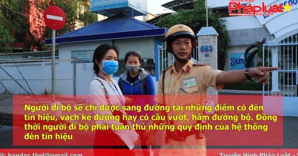 TP HCM: Hàng loạt người đi bộ bị CSGT nhắc nhở vì vi phạm luật giao thông