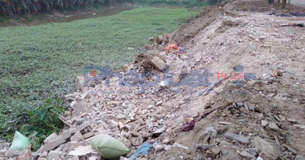 Điều tra xử lý nghiêm cá nhân, tập thể ngang nhiên đổ phế thải lấn chiếm sông Hồng